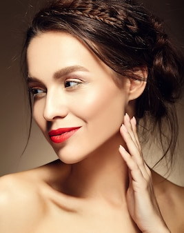 Portrait of beautiful woman model with fresh daily makeup and red lips