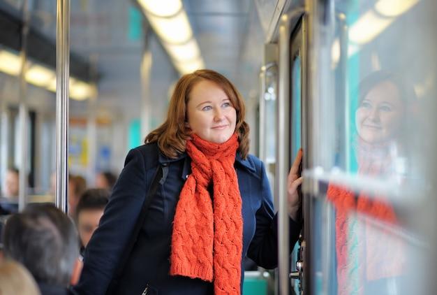 Portrait of beautiful woman in parisian metro