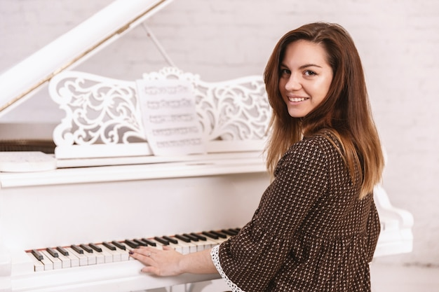 Portrait of a beautiful woman playing the piano