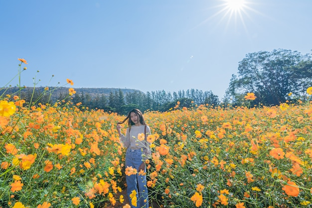 Portrait of a beautiful woman poses for photography visit the yellow flower fields at jim thompson farm