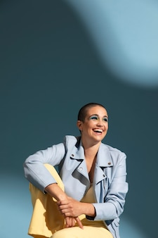 Portrait of beautiful woman posing with a blue jacket