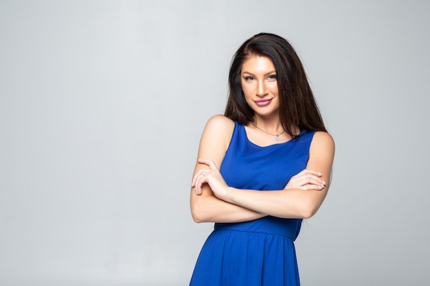Portrait of a beautiful woman standing with arms folded.