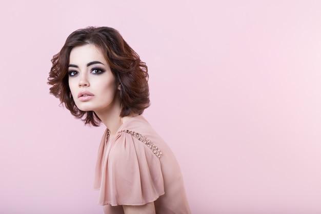 Portrait of beautiful woman in the studio