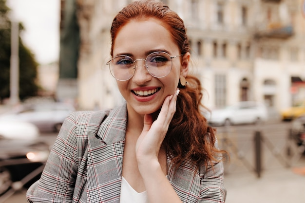 Portrait of beautiful woman in trendy eyeglasses