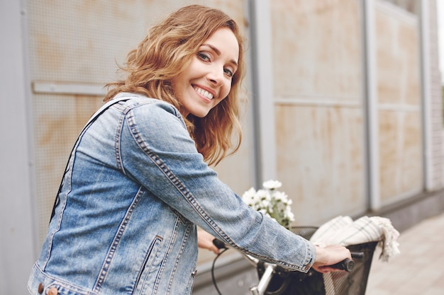 Portrait of beautiful woman with bike
