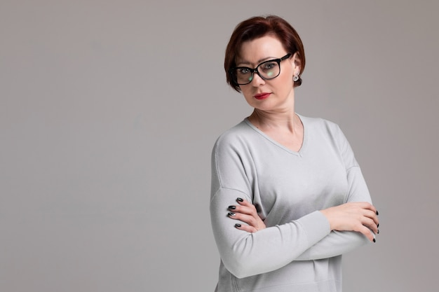 Portrait of beautiful woman with glasses isolated on light