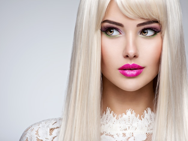 Portrait of  a  beautiful  woman with long white straight  hairs and bright make-up.  face of a fashion model with pink lipstick. pretty girl posing .