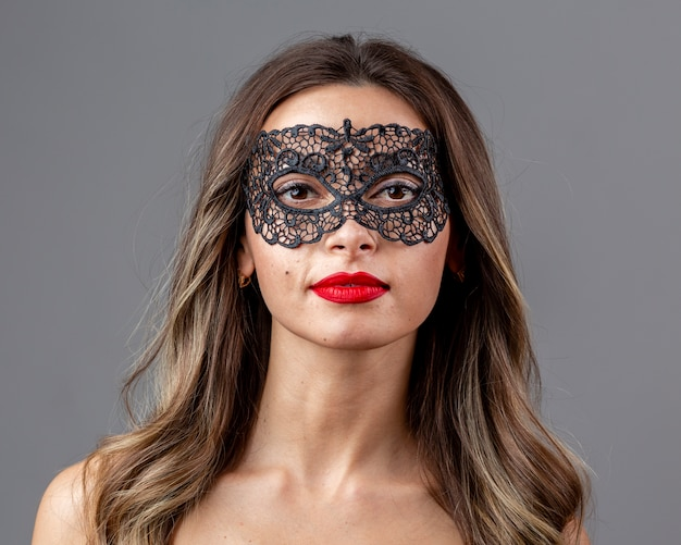 Portrait of beautiful woman with mask