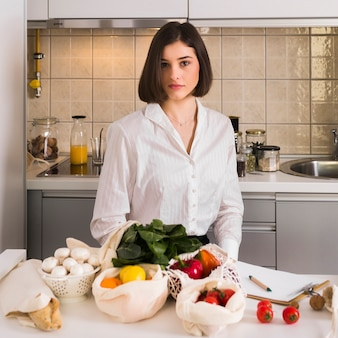 Portrait of beautiful woman with organic groceries