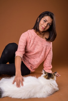 Portrait of beautiful woman with pet cat