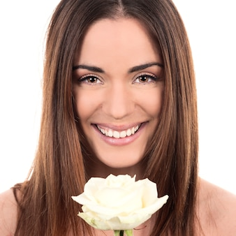 Portrait of beautiful woman with white rose