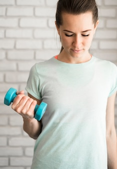 Portrait of beautiful woman working out at home