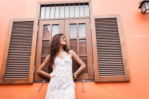 Portrait of  beautiful women standing at wooden window
