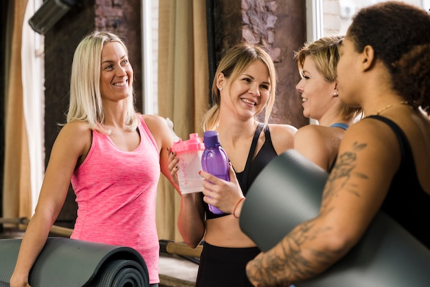 Portrait of beautiful women together at the gym