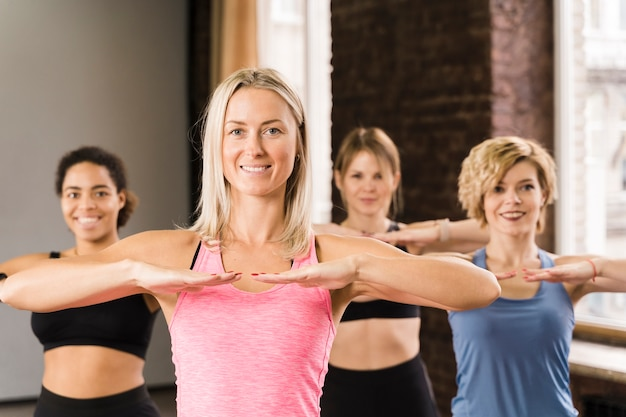 Portrait of beautiful women working out together