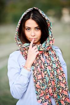 Portrait of beautiful yang dark haired girl outdoor.