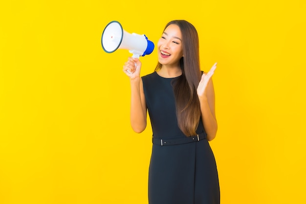 Portrait beautiful young asian business woman use megaphone for communication