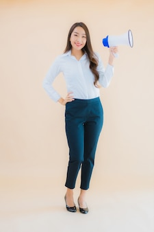 Portrait beautiful young asian business woman with megaphone for cummunication