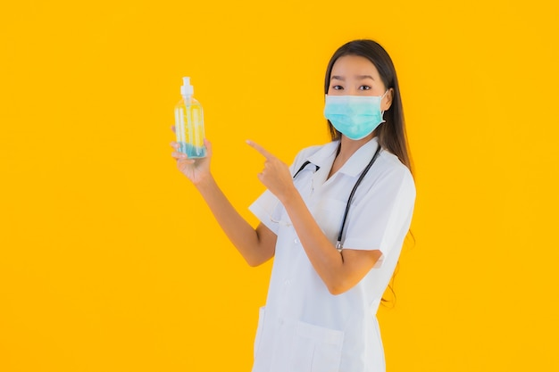 Portrait beautiful young asian doctor woman wear mask with alcohol gel