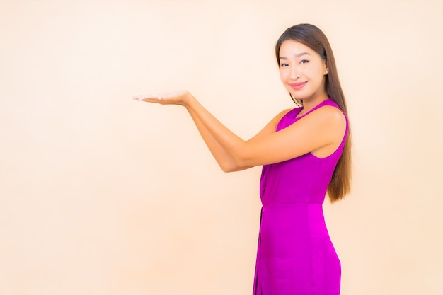 Portrait beautiful young asian woman in action on color isolated background