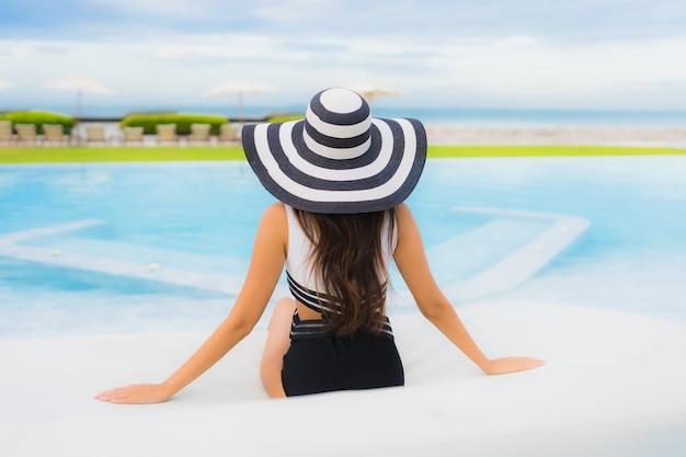 Portrait beautiful young asian woman around swimming pool