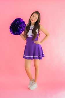 Portrait beautiful young asian woman cheerleader smile happy