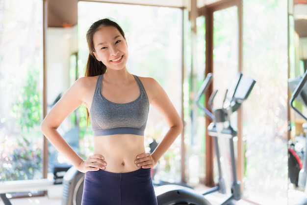 Portrait beautiful young asian woman exercise with fitness equipment in gym interior