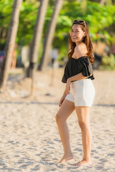 Portrait beautiful young asian woman happy and smile on the beach sea and ocean