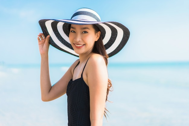 Portrait beautiful young asian woman happy and smile on the beach and sea