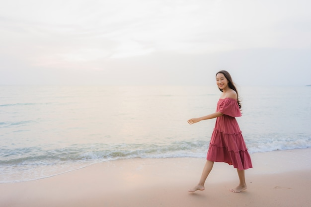 Portrait beautiful young asian woman happy smile leisure on the beach sea and ocean