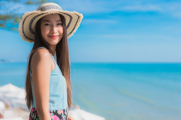 Portrait beautiful young asian woman happy smile relax around beach ocean and sea