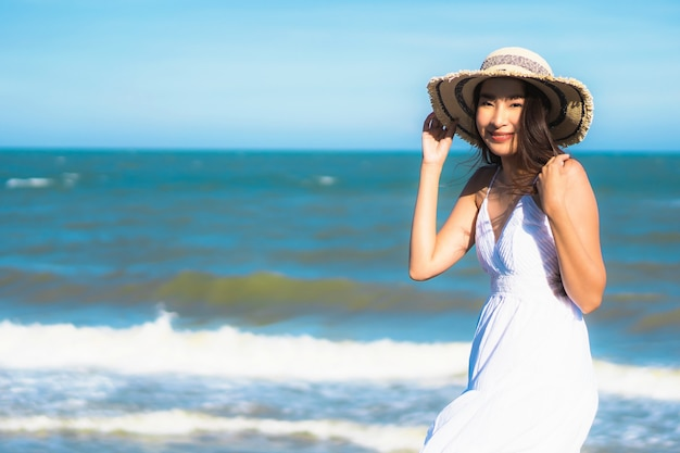 Portrait beautiful young asian woman happy smile relax around neary beach and sea