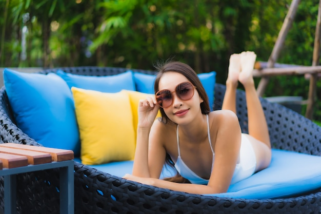 Portrait beautiful young asian woman happy smile relax around outdoor swimming pool