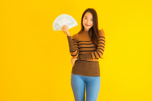 Portrait beautiful young asian woman happy smile and rich with a lot of cash in her hand