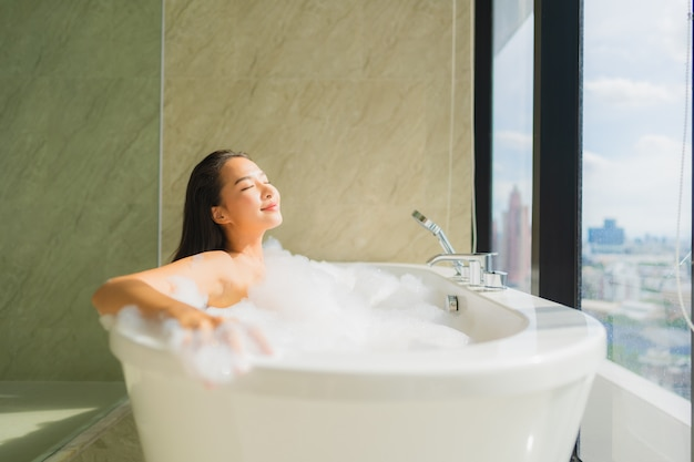 Portrait beautiful young asian woman relax and leisure in bathtub