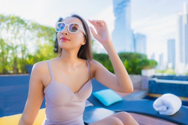 Portrait beautiful young asian woman relax leisure enjoy around outdoor swimming pool