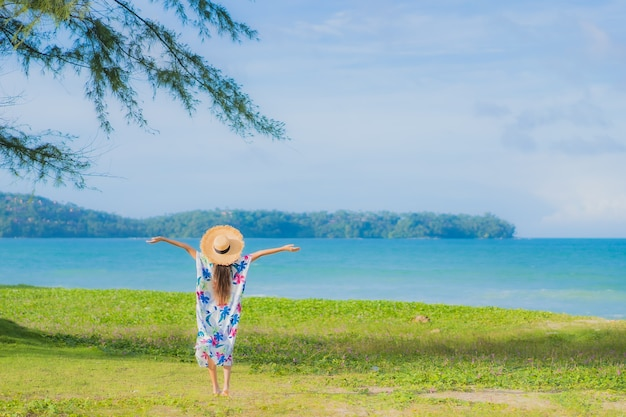 Portrait beautiful young asian woman relax smile around beach sea ocean in holiday vacation