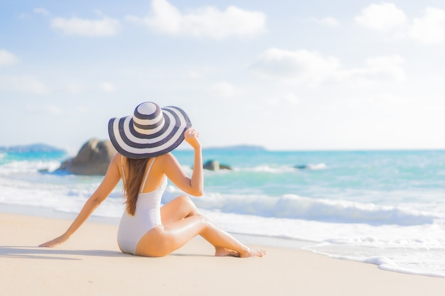 Portrait beautiful young asian woman relax smile leisure around beach sea ocean on travel vacation trip