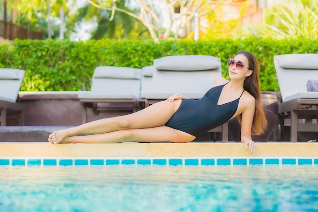 Portrait beautiful young asian woman relax smile leisure around outdoor swimming pool nearly sea
