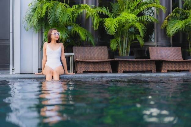 Portrait beautiful young asian woman relax smile leisure around outdoor swimming pool