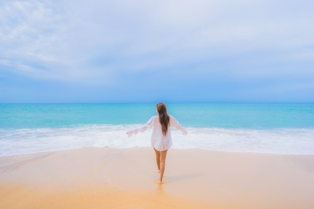Portrait of beautiful young asian woman relaxing around beach sea ocean in travel vacation