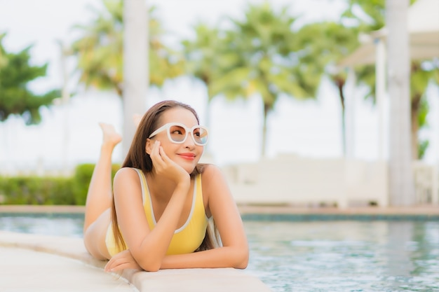 Portrait beautiful young asian woman relaxing outdoor in swimming pool in holiday trip