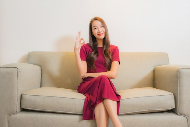 Portrait beautiful young asian woman relaxing on sofa in living room interior