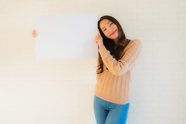 Portrait beautiful young asian woman show blank white paper board