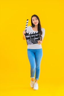 Portrait beautiful young asian woman show clapper movie board