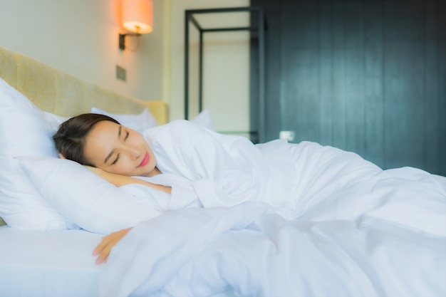 Portrait beautiful young asian woman sleep on bed with pillow and blanket