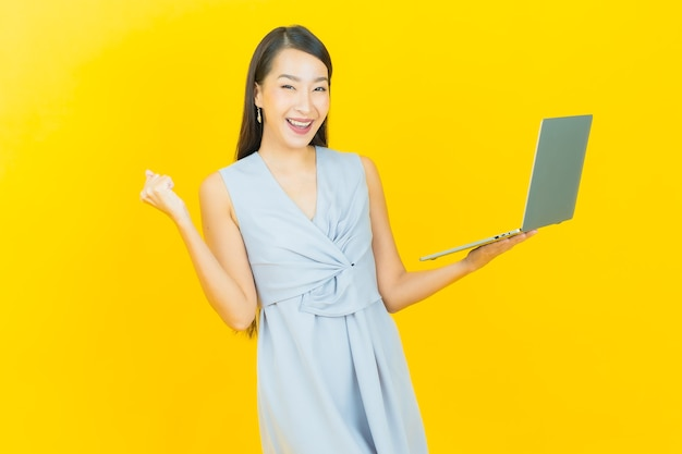Portrait beautiful young asian woman smile with computer laptop on isolated background