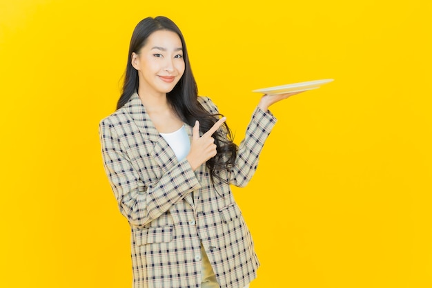 Portrait beautiful young asian woman smile with empty plate dish