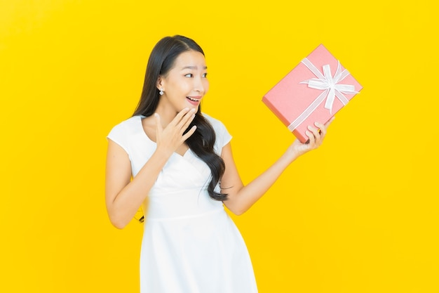 Portrait beautiful young asian woman smile with red gift box