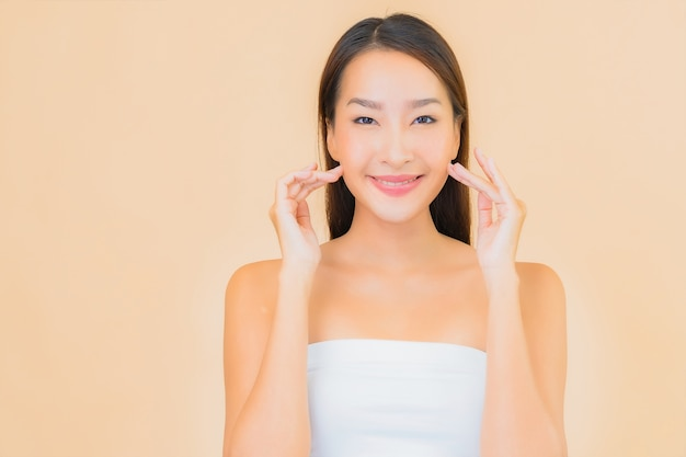 Portrait beautiful young asian woman in spa with natural makeup on beige